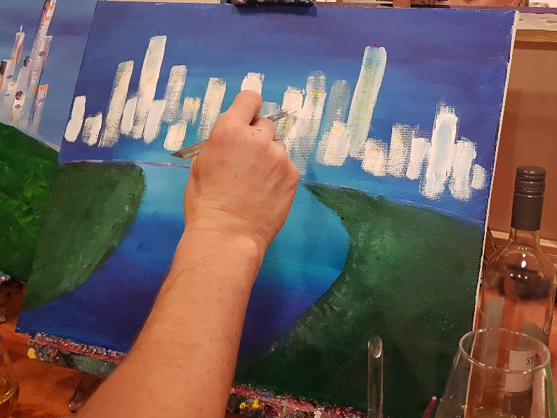Cork & Chroma - A Paint and Sip Studio in Brisbane - David painting Brisbane skyline