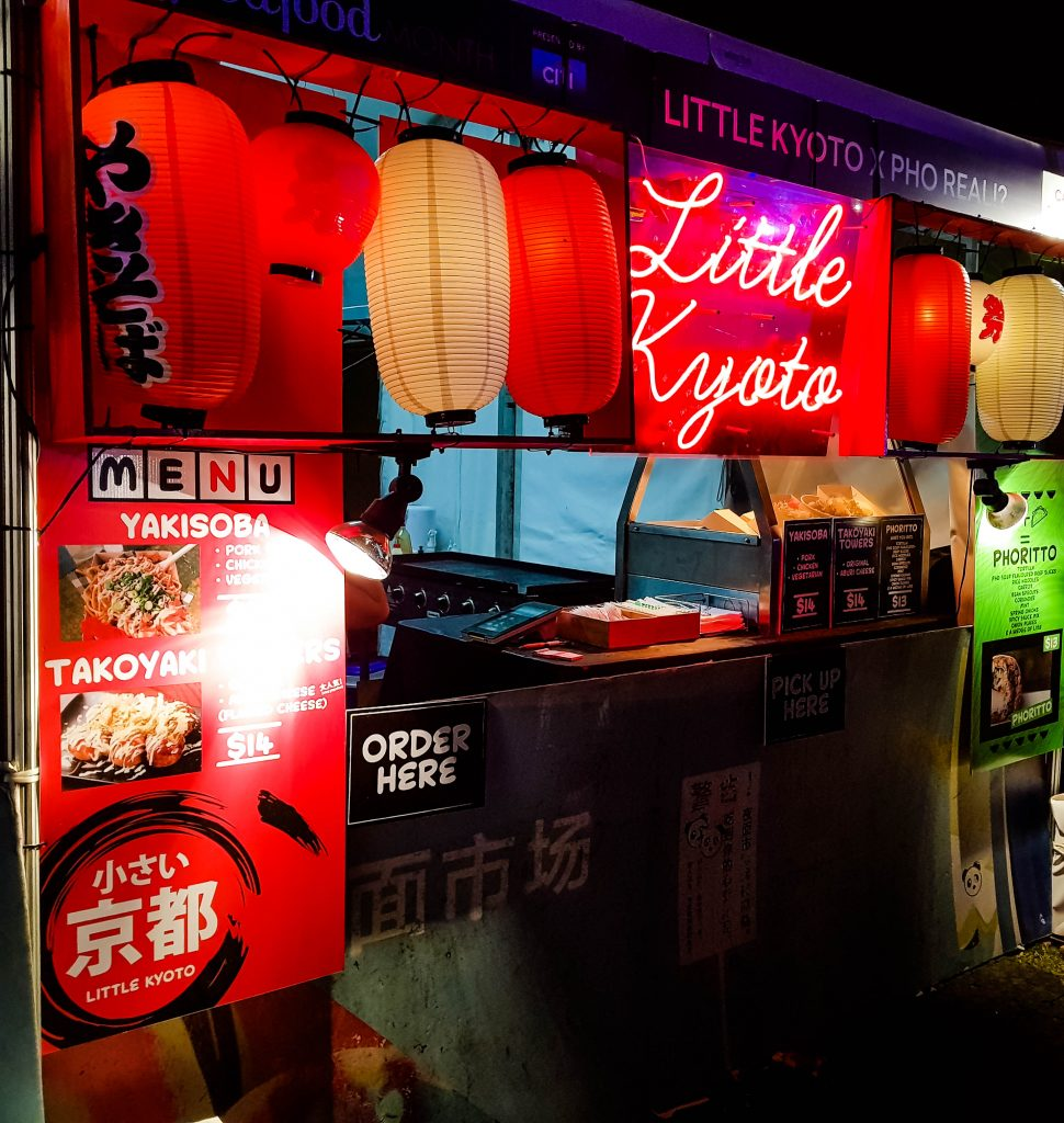 Red and yellow lantern lit pop up food stall