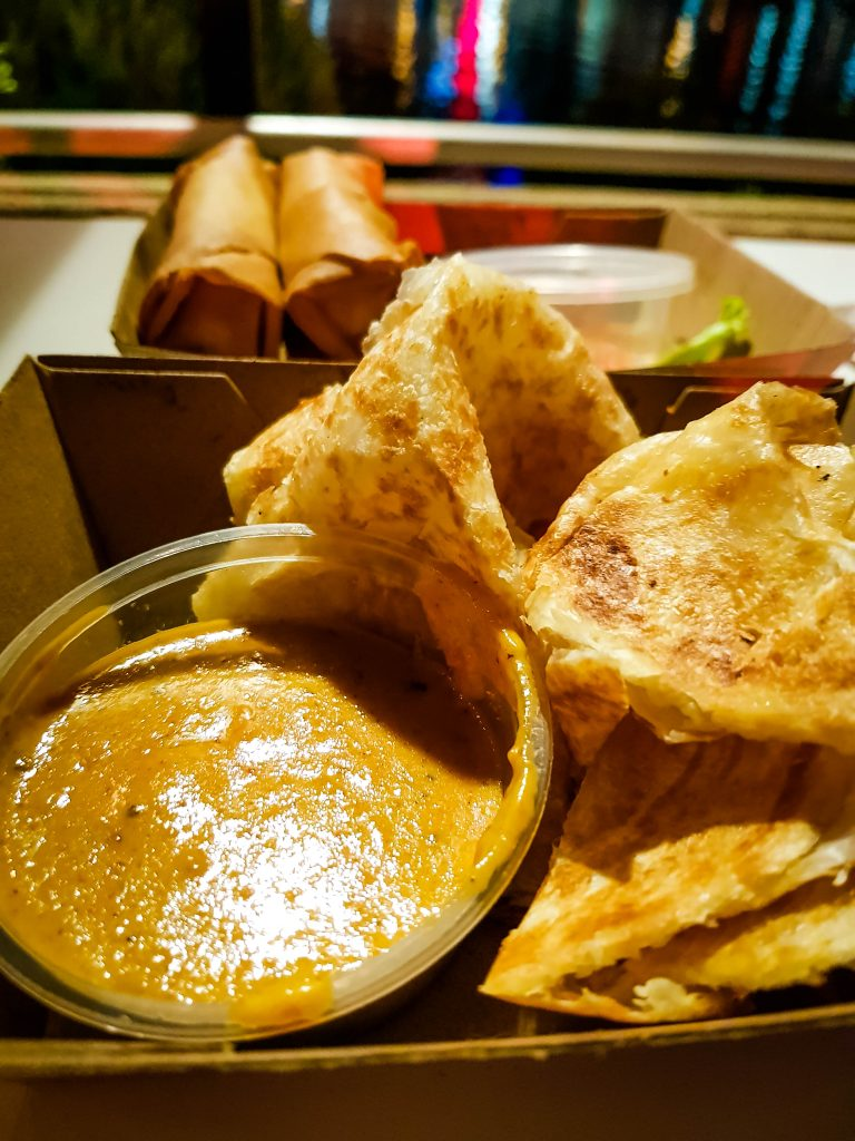 Spring rolls, roti bread and peanut dipping sauce