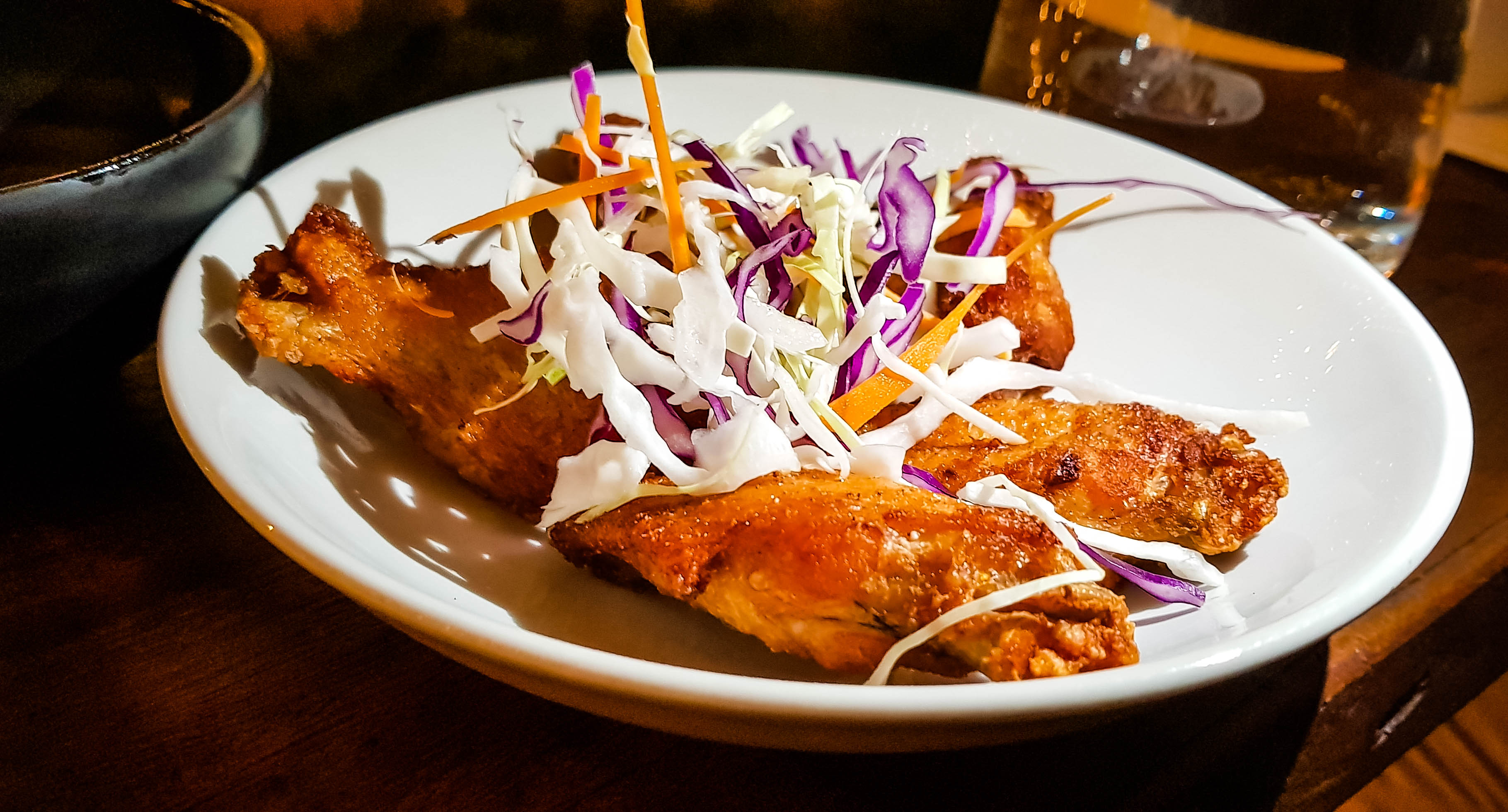 Plate of chicken wings and coleslaw